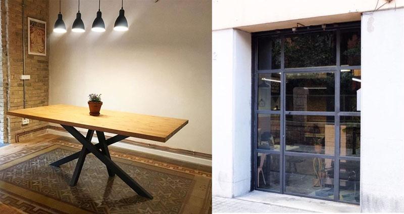 Una mesa y una puerta de metal de Aina Sanfeliu